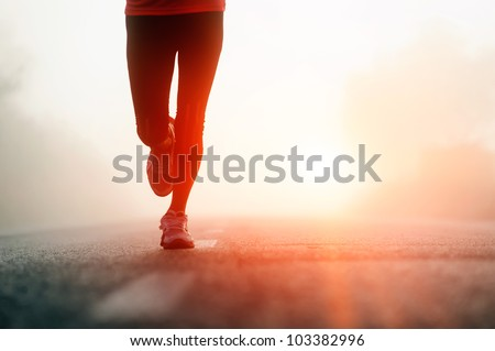 runner feet running on road