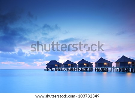 water villa cottages at sunset
