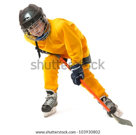 boy in yellow hockey uniform