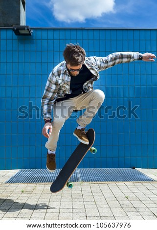 skateboarder jumping on