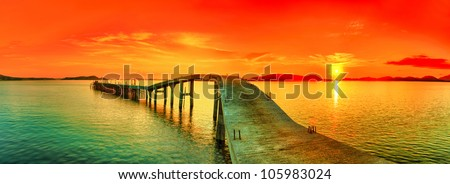 sunset over the sea pier on