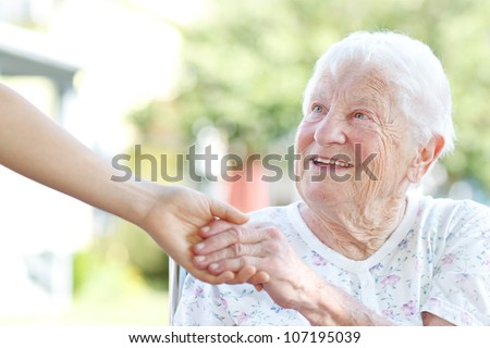 happy senior woman holding
