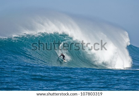extreme surfers riding some