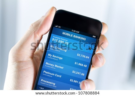 a man holding mobile smart