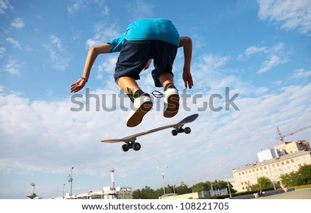 skater jumps high in air on