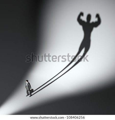 business man casting a shadow