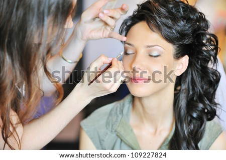 young beautiful bride applying