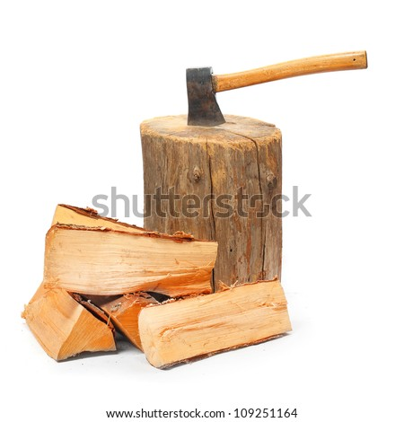 cut logs fire wood and old axe