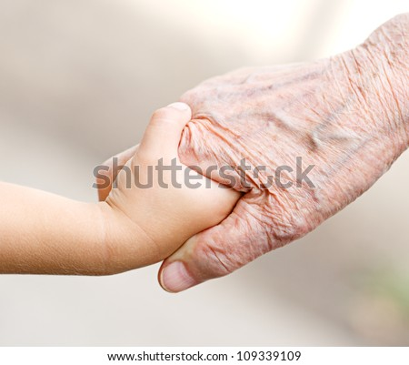 an old woman and a kid holding