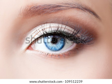 woman blue eye with extremely