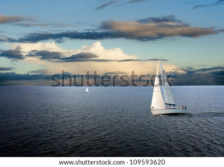 sail boats on sea with cloudy