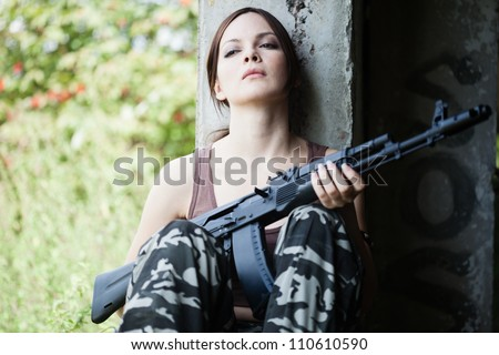 young woman with rifle