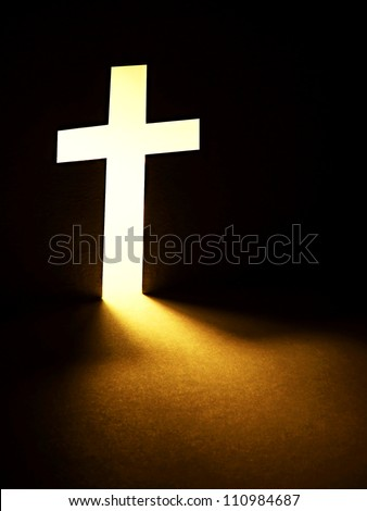 cross with light shafts faith