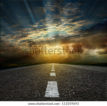 asphalt road between fields