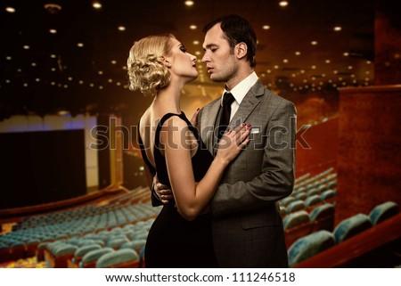 couple in theatre interior
