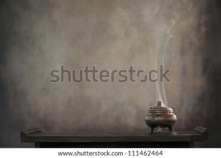 incense burner on table