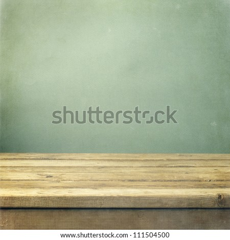wooden deck table on green
