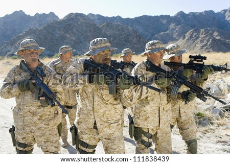 squad with rifles on a mission