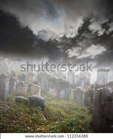 old ruined graveyard in mystery