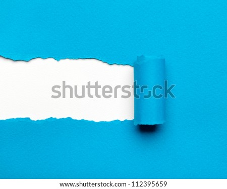 torn light blue paper with