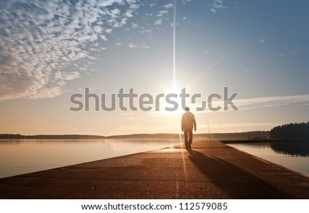 a man goes on the concrete pier