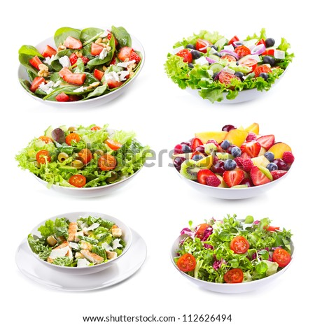 set with different salads on...