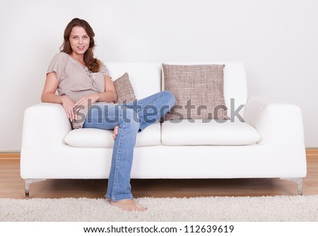 casual barefoot woman in jeans
