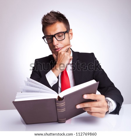 intrigued business man reading