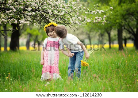 two young children kissing in