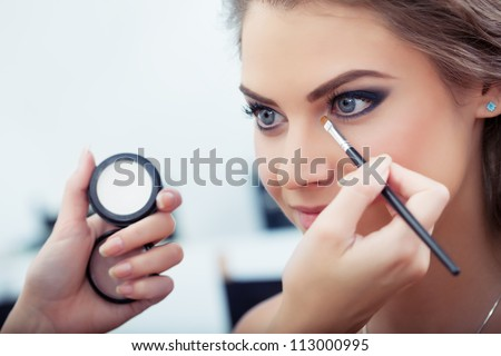 make up artist applying white