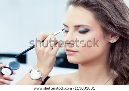 make up artist applying bright