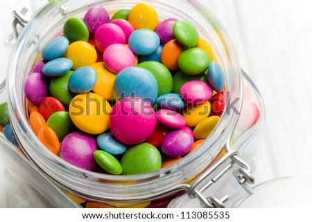 the colored candy in glass jar
