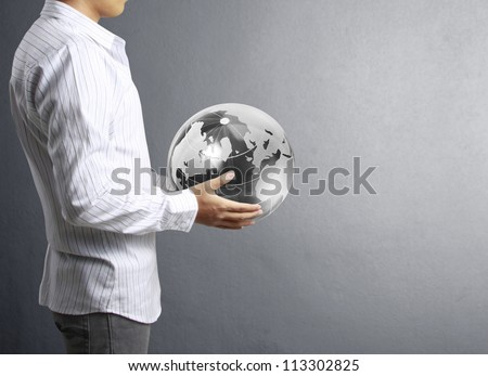 holding a glowing earth globe