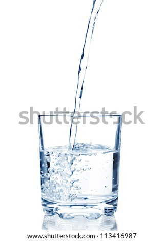water pouring in glass isolated