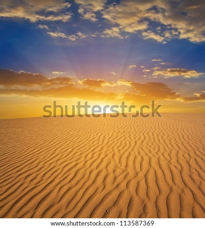 sunset in a sand desert