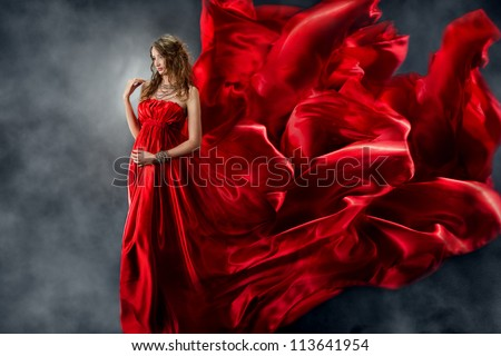 woman in red dress waving on