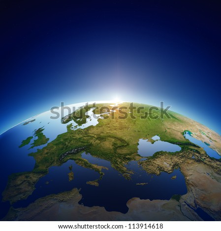 planet earth with sun rising