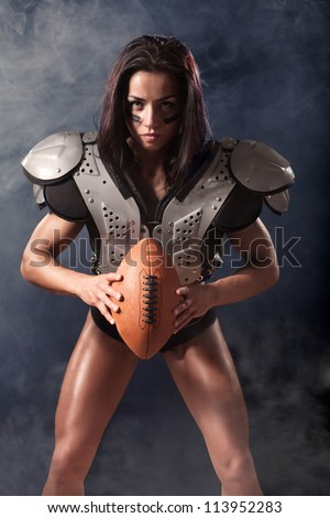 quarterback girl with a ball in