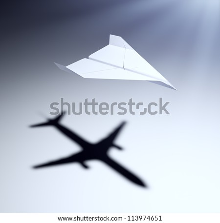 paper airplane casting a shadow