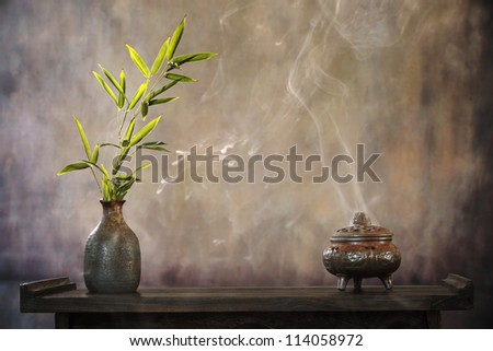 incense burner and bamboo leaf