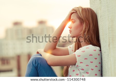 beautiful lonely girl sitting