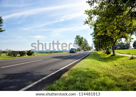 car traveling on a country road