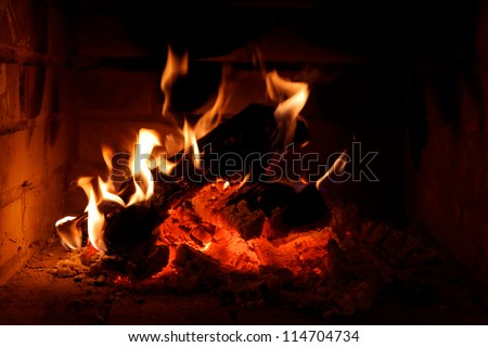 a fire burning in an open fire