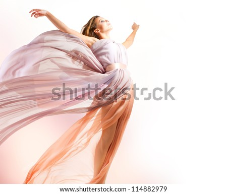 beautiful girl in blowing dress