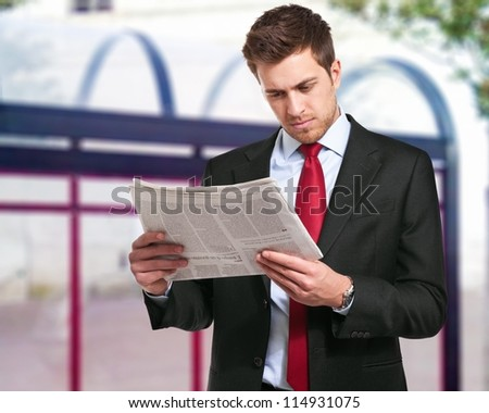 a businessman reads the finance