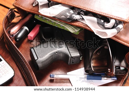 a gun in a purse