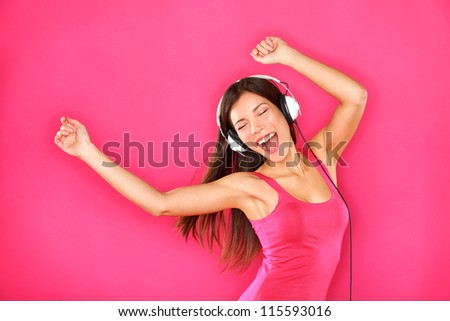 woman dancing listening to