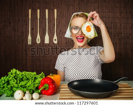 happy funny woman cook holding