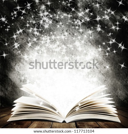old open book with magic light