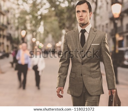 man in classic grey suit with